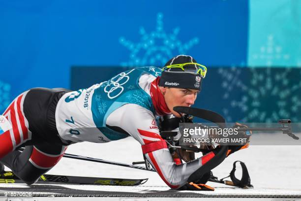 Austria's Tobias Eberhard competes at the shooting range in the men's 20km individual biathlon event during the Pyeongchang 2018 Winter Olympic Games...