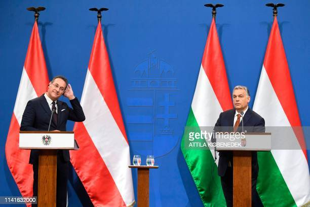 Austria's ViceChancellor and chairman of the Freedom Party FPOe HeinzChristian Strache and Hungarian Prime Minister Viktor Orban give a press...