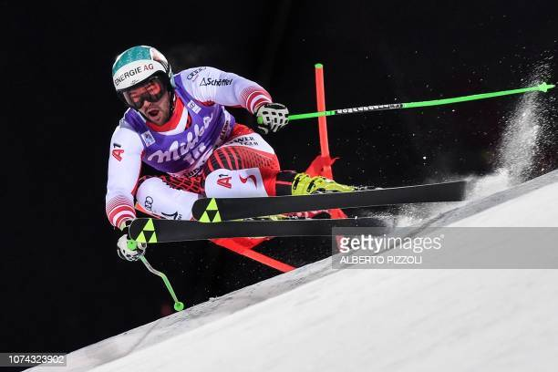 Austria's Vincent Kriechmayr competes in the 1/16th final of the FIS Alpine World Cup Men's Parallel Giant Slalom nightrace on December 17, 2018 in...