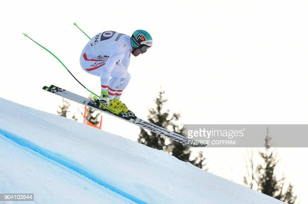 Austria's Vincent Kriechmayr competes in the Downhill race of the men's Alpine Combined at the FIS Alpine Skiing World Cup in Wengen on January 12...
