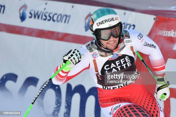 Austria's Vincent Kriechmayr reacts as he crosses the finish line after competing in the Men's Downhill of the Lauberhorn during the FIS Alpine Ski...