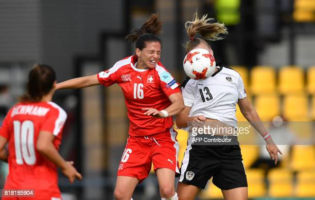 Austria's Virginia Kirchberger vies with Switzerland's Fabienne Humm during the UEFA Womens Euro 2017 football tournament match between Austria and...