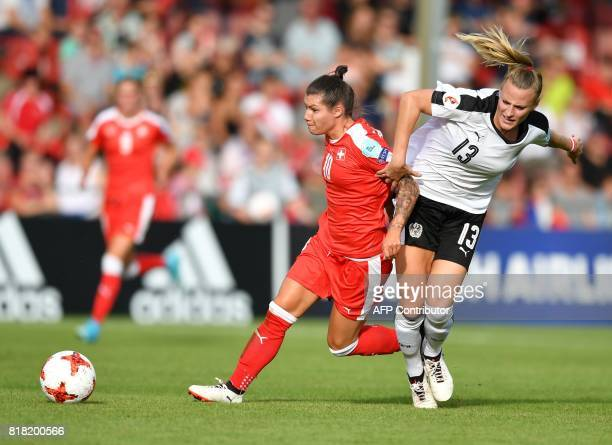 Austria's Virginia Kirchberger vies with Switzerland's Ramona Bachmann during the UEFA Womens Euro 2017 football tournament match between Austria and...
