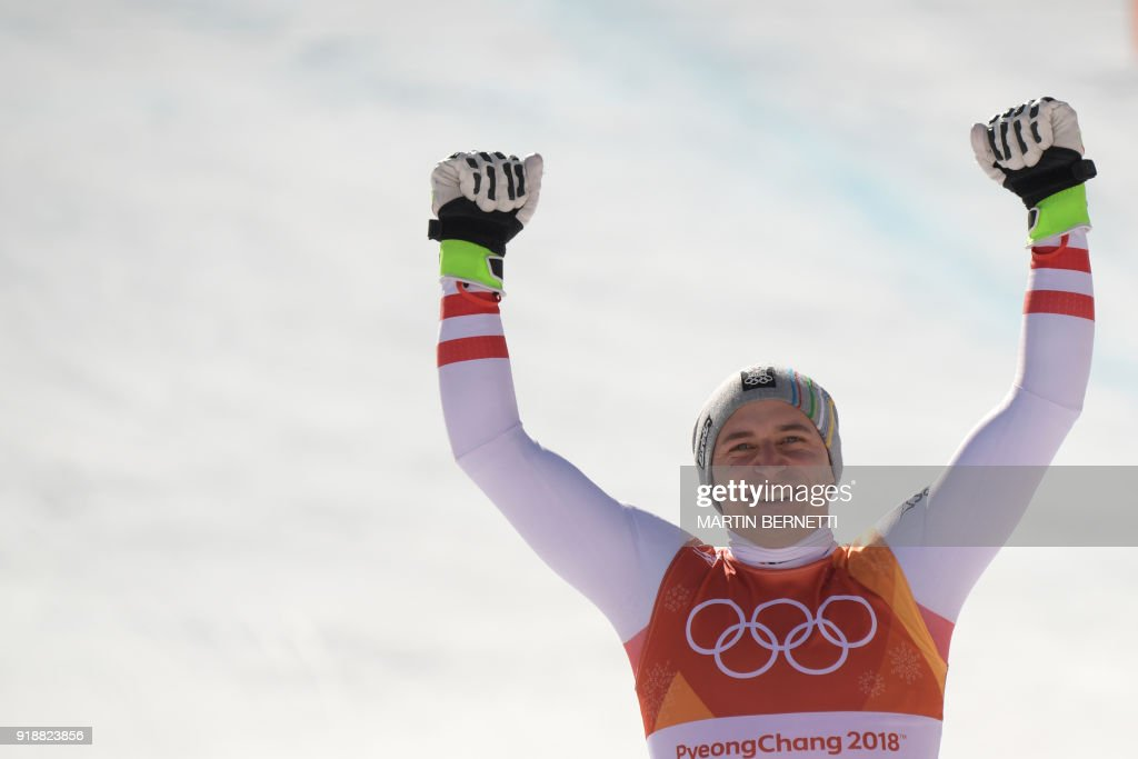 TOPSHOT - Austria's winner Matthias Mayer celebrates on the podium during the victory ceremony at the end of the Men's Super-G at the Jeongseon Alpine Center during the Pyeongchang 2018 Winter Olympic Games in Pyeongchang on February 16, 2018. / AFP PHOTO / Martin BERNETTI