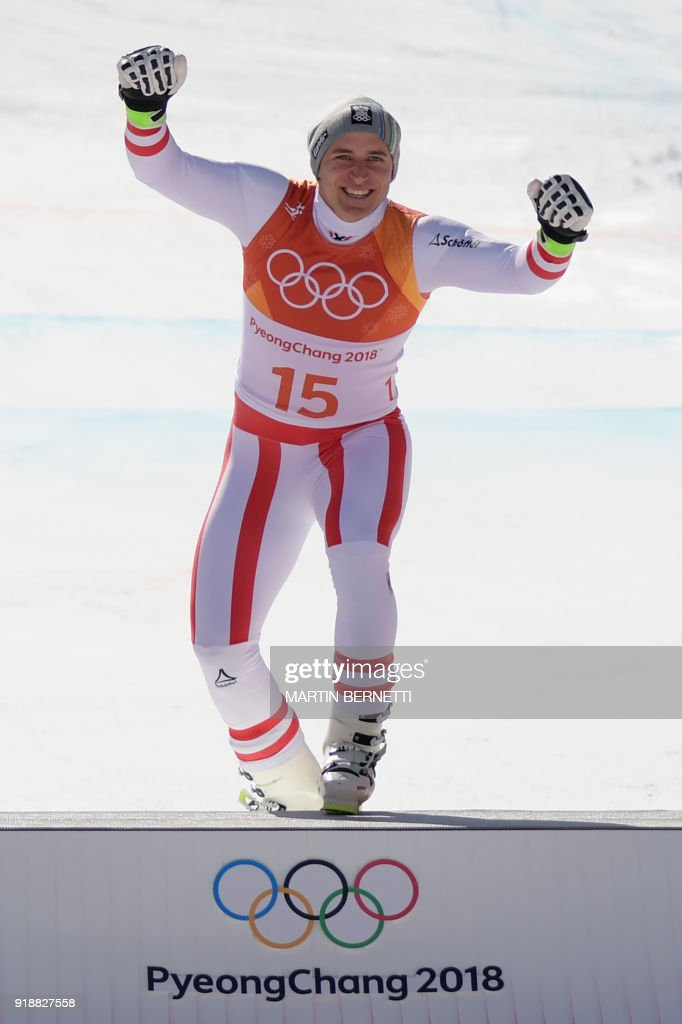 Austria's winner Matthias Mayer reacts on the podium during the victory ceremony at the end of the Men's Super-G at the Jeongseon Alpine Center during the Pyeongchang 2018 Winter Olympic Games in Pyeongchang on February 16, 2018. / AFP PHOTO / Martin BERNETTI