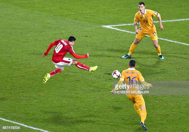 Austria's Zlatko Junuzovic vies with Moldavia's Vadim Bolohan and Veaceslav Posmac during the FIFA World Cup 2018 qualification football match...