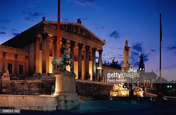 Austria,Vienna,Parliament building illuminated at dusk