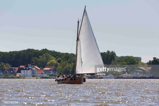 Auswanderer, traditional wooden sailboat sailing with tourists on Steinhuder Meer / Lake Steinhude, Lower Saxony / Niedersachsen, Germany.