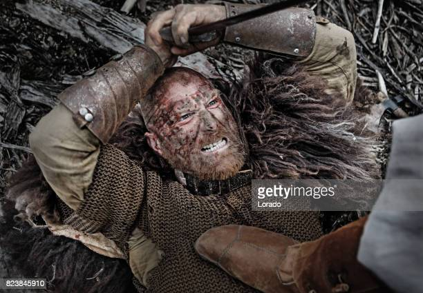 authentic caucasian bearded viking warrior in outdoor forest setting - barbarian stock photos and pictures