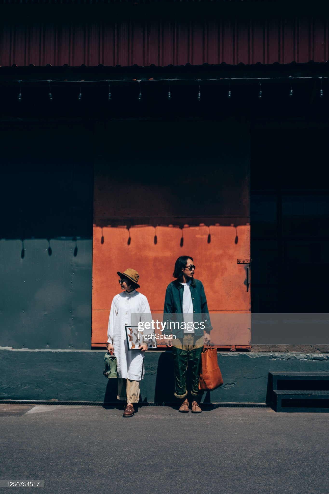 Authentic Couples: Portrait of a Cool Asian Couple Standing on the Street : Stock Photo