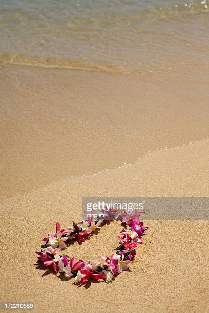 authentic hawaiian lei on the beach - hawaiian lei stock pictures, royalty-free photos & images