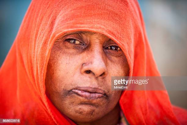 Authentic Indian woman with wearing traditional clothing and veil in Sabalpura, Rajasthan, India
