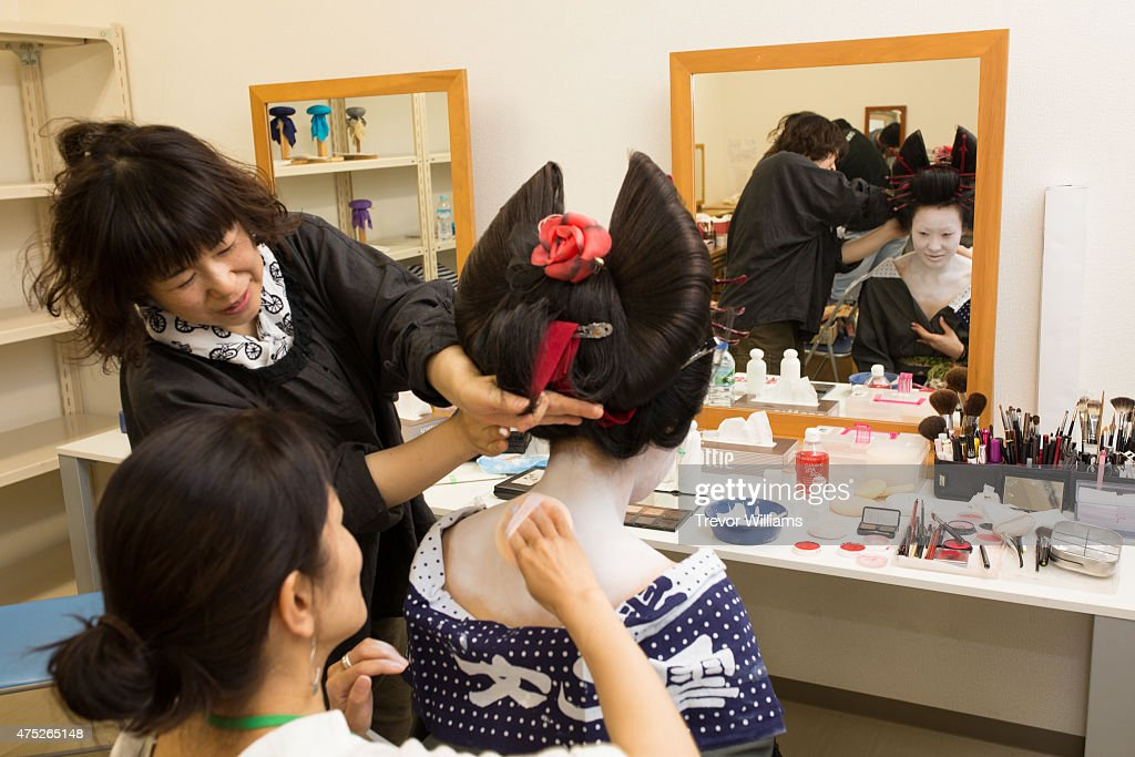 Authentic make up and wardrobe are used during the Uzumasa Edosakaba, an event recreating an edo-period bar at the Toei Kyoto Studio Park on May 30, 2015 in Kyoto, Japan. The Toei Kyoto Studio Park, a studio park built next to a working film set, turned itself into a big edo-period bar where people can drink and enjoy edo period culture including Japanese cuisine and samurai sword fighting.