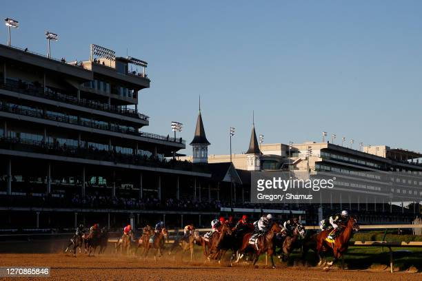 Authentic, ridden by jockey John Velazquez leads the field around the first turn during the 146th running of the Kentucky Derby at Churchill Downs on...