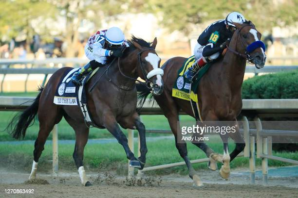 Authentic, ridden by jockey John Velazquez leads Tiz the Law, ridden by jockey Manny Franco, down the stretch on the way to winning the 146th running...