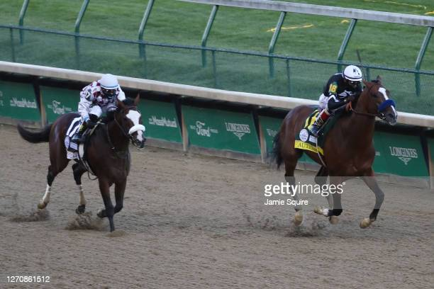 Authentic, ridden by jockey John Velazquez runs down the stretch to win the 146th running of the Kentucky Derby at Churchill Downs on September 05,...