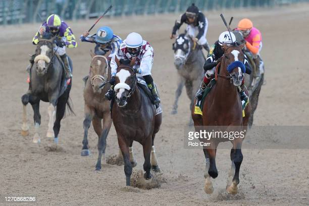 Authentic, ridden by jockey John Velazquez runs down the stretch to win the 146th running of the Kentucky Derby past Tiz the Law, ridden by jockey...