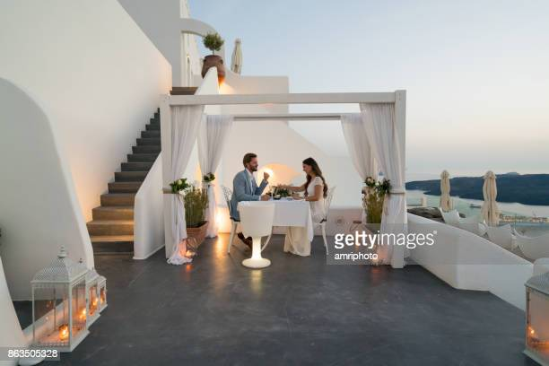 authentic wealth - dinner for two on private porch - evening meal stock pictures, royalty-free photos & images