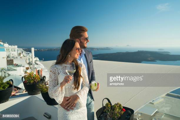 authentic wealth - stylish rich couple on honeymoon in greece - honeymoon stock pictures, royalty-free photos & images