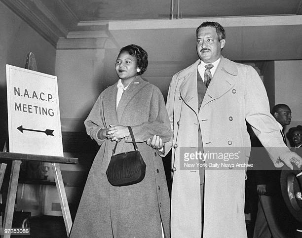 Autherine Lucy and her lawyer Thurgood Marshall entering the NAACP office for a press conference