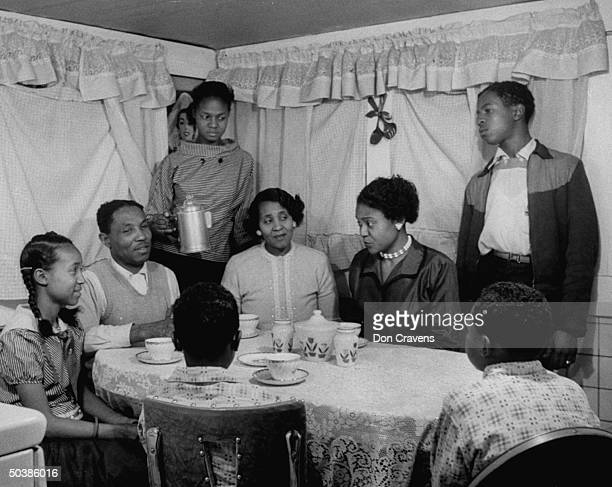 Autherine Lucy , first African American to enter the University of Alabama, with family of brother-inlaw. Her challenge to school segregation was met...