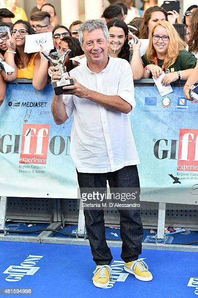 Author Alessandro Baricco poses with The Best Talent Award during Giffoni Film Festival 2015 on July 22 2015 in Giffoni Valle Piana Italy