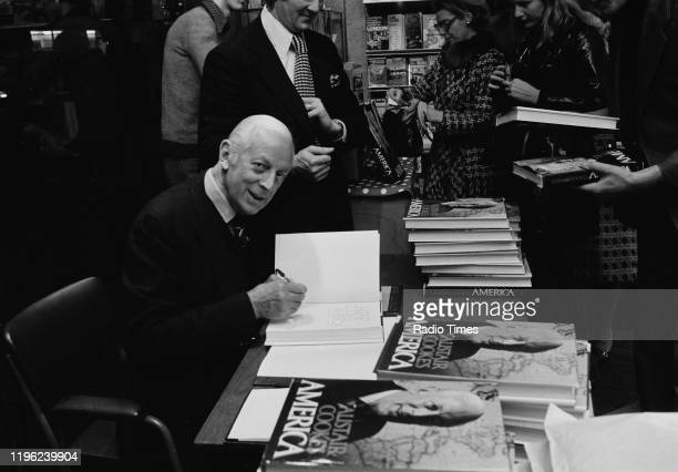 Author Alistair Cooke signing copies of his book 'Alistair Cooke's America' at Claude Gill Books, Oxford Street, London, November 26th 1973.