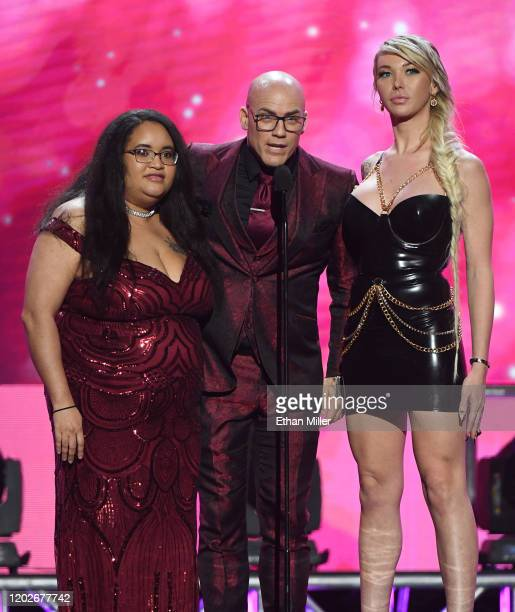 Author Amberly Rothfield adult film actor/director Derrick Pierce and adult film actress Aubrey Kate present an award during the 2020 Adult Video...