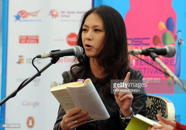 US author Amy Chua gestures as she reads an excerpt from her book 'Tiger Mothers' during DSC Jaipur Literature Festival in Jaipur on January 21 2012...