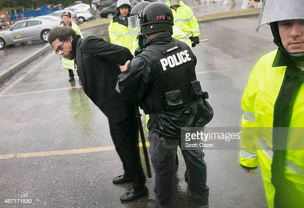 Author and activist Cornel West is arrested following a show of civil disobedience outside the Ferguson police station on October 13 2014 in Ferguson...