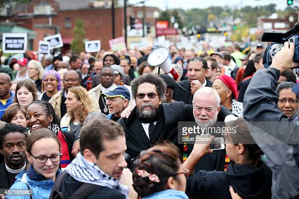 Author and activist Cornel West members of the clergy and other demonstrators protest outside the Ferguson police station on October 13 2014 in...