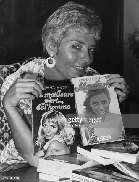 Author and former sex worker Xaviera Hollander in her apartment in Paris France with her two bestsellers 'Madam' and 'La Meilleure Part de l'Homme'...