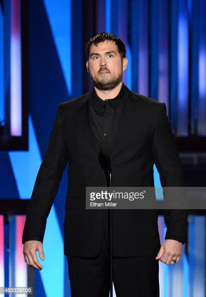 Author and former US Navy SEAL Marcus Luttrell speaks onstage during ACM Presents An AllStar Salute To The Troops at the MGM Grand Garden Arena on...