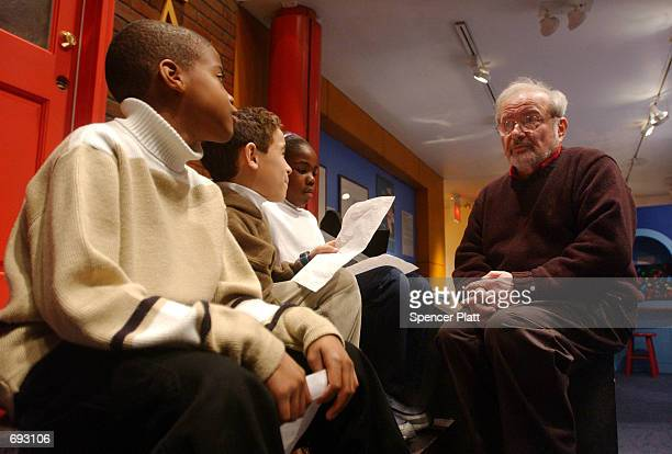 Author and illustrator Maurice Sendak speaks with children January 11 2002 before the opening of an exhibition entitled 'Maurice Sendak In His Own...