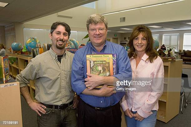 Author and illustrator Michael Stadther poses with David Cohen and Amy StilesKeller after he read from his new book 'Secrets of the Alchemist Dar' to...