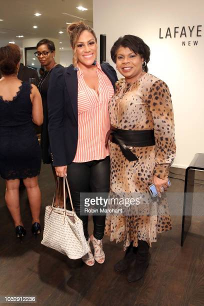 Author and journalist April Ryan poses with a guest at Lafayette 148 New York x April Ryan Under Fire Book Launch on September 13 2018 in New York...