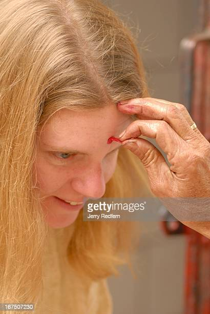 Author and journalist Karen Coates receives a Tilak from a Brahmin priest at Mahakal Temple atop Observatory Hill The hilltop is sacred to Hindus and...