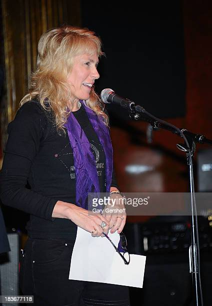 Author and photographer Lisa Johnson speaks on stage for the book launch of '108 Rock Star Guitars' benefitting The Les Paul Foundation at The...