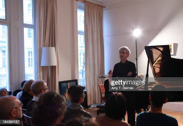 Author and pianist Paul Roberts reads from his new book 'Reflections: The Piano Music of Maurice Ravel' near a grand piano in the Salon during 'It's...