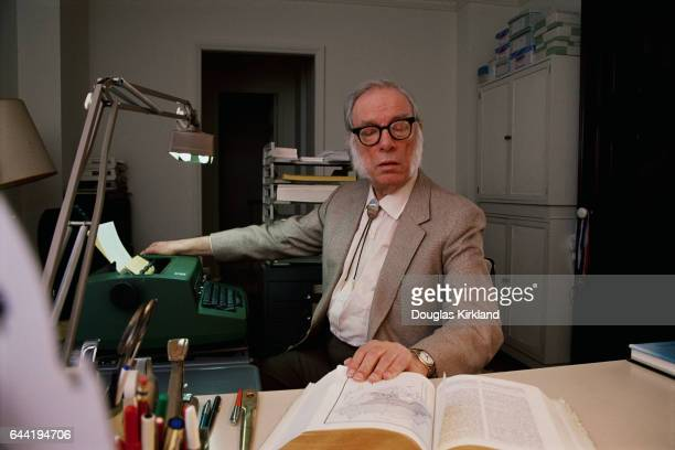 Author and Scientist Isaac Asimov Looking at a Reference Book