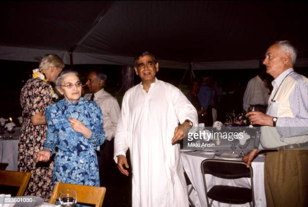 Author and screenwriter Ruth Prawer Jhabvala Producer Ismail Merchant and Director James Ivory Vanessa Redgrave in background prepare for a dinner...