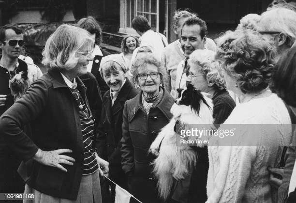 Author and television personality Barbara Woodhouse pictured talking a crowd of people during the filming of the television show 'Woodhouse Roadshow'...