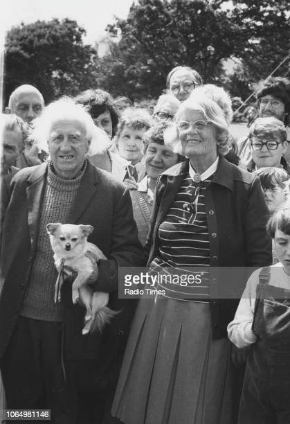 Author and television personality Barbara Woodhouse pictured with a crowd of people during the filming of the television show 'Woodhouse Roadshow'...
