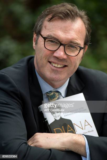 Author Andrew Morton poses with a copy of his book 'Diana Her True Story In Her Own Words' at his home in London on August 24 2017 Princess Diana...
