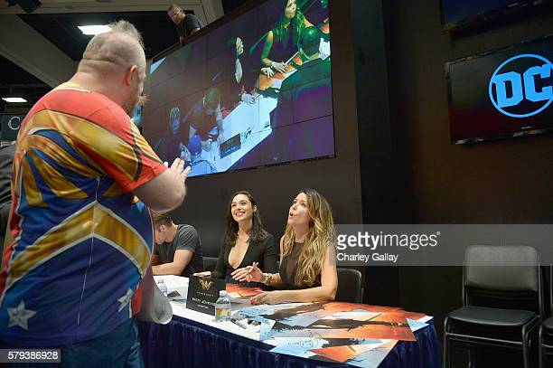 Author Andy Mangels actress Gal Gadot and director Patty Jenkins from the 2017 feature film Wonder Woman sign autographs for fans in DC's 2016 San...