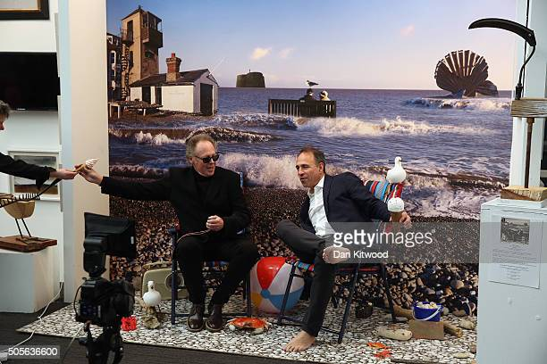 Author Anthony Horowitz takes part in a photocall having his picture taken by Bill Jackson in a seaside setting at the 28th London Art Fair held in...