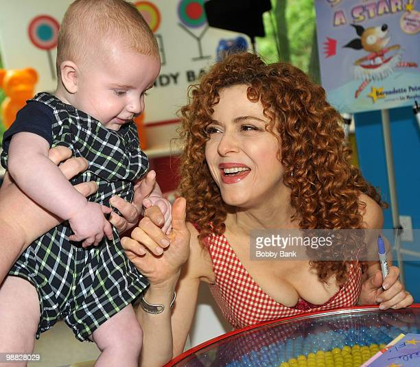 Author Bernadette Peters and fan promote 'Stella is a Star' at Dylan's Candy Bar on May 3 2010 in New York City