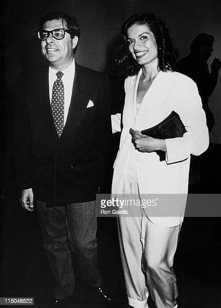 Author Bob Colacello and Bianca Jagger attend the book party for 'Holy Terror Andy Warhol Close Up' on August 8 1990 at the Factory in New York City