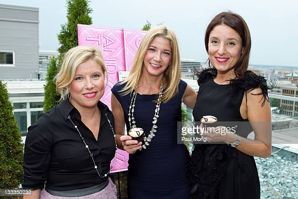 Author Candace Bushnell poses for a photo with Sophie LaMontagne and Katherine Kallinis of Georgetown Cupcake at Candace Bushnell's 'Summer in the...
