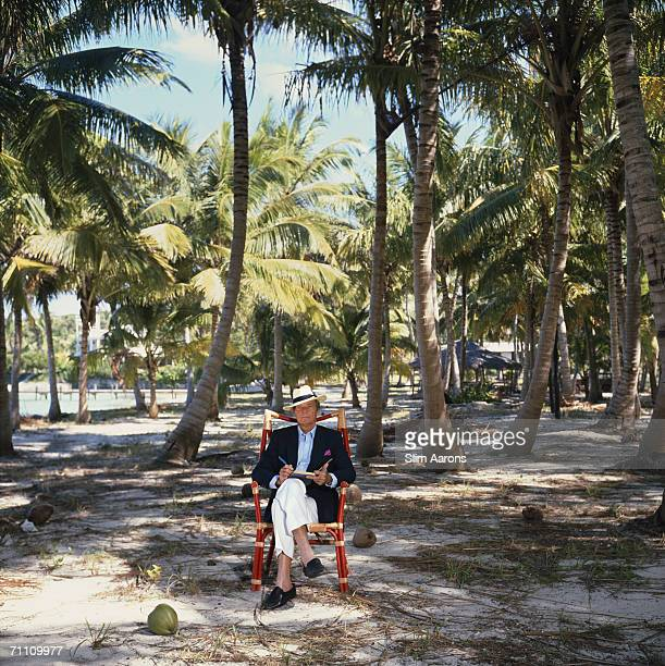 Author Chester Thompson at work in his coconut grove on the Abaco Islands of the Bahamas March 1986 His ancester Wyannie Malone settled on the...